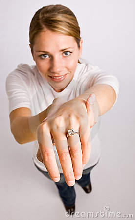 Woman displaying engagement ring