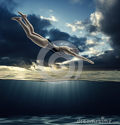 Woman dives into the water