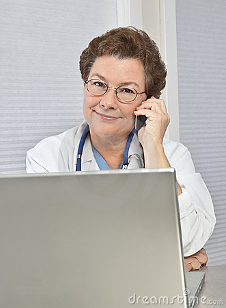 Woman Doctor at Computer, Talking on Phone