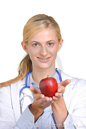Woman doctor holding an apple