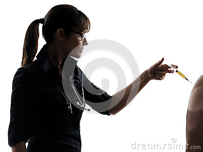 Woman doctor holding surgical needle vaccination silhouette