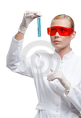 Woman doctor in spectacles hands a vial