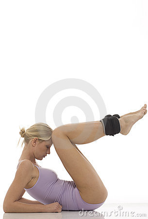 Free Woman Does Gymnastics With Ankle Weights Stock Photo - 16441240
