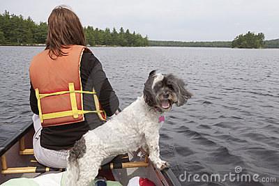 Woman and dog in canoe