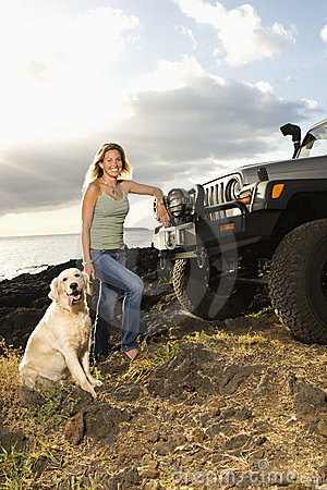 Woman and Dog by SUV at the Beach