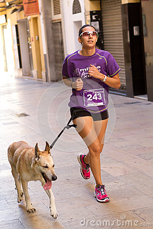 Woman and dog Editorial Stock Image