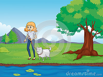 A woman with a dog walking along the river