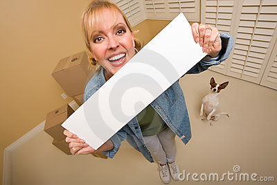 Woman and Doggy with Blank Sign Near Moving Boxes