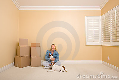 Woman and Dogs with Moving Boxes in Room on Floor