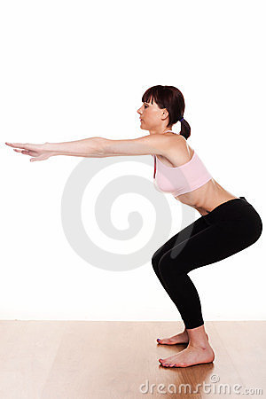 Free Woman Doing A Squat Exercise Stock Image - 23901051