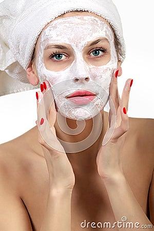 Woman doing cosmetic mask