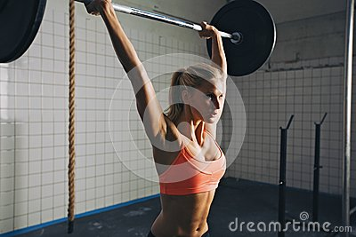 woman doing crossfit barbell lifting stock photo  image