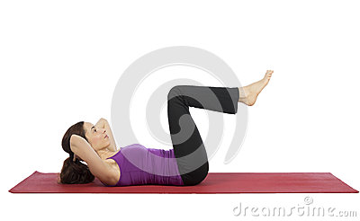 Woman doing crunch during fitness Stock Photo