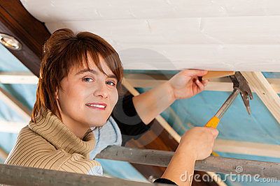 Woman doing dry walling, working