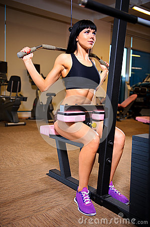 Woman doing exercises at the gym