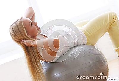 Woman doing exercises with gymnastic ball