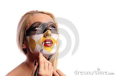 Woman doing fashion make-up