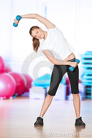 Woman doing fitness exercise at sport gym