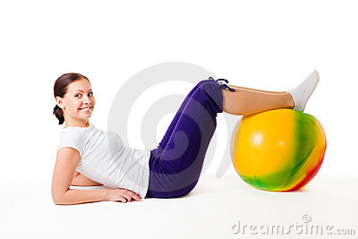 Woman doing fitness exercises with ball