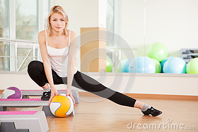 Woman doing fitness in a gym