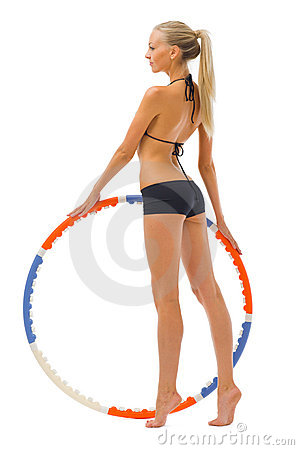 Woman is doing gym exercises with hoop