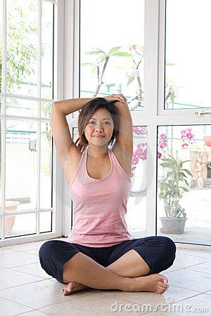 Woman doing her arm stretching exercise