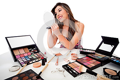 Woman doing her makeup