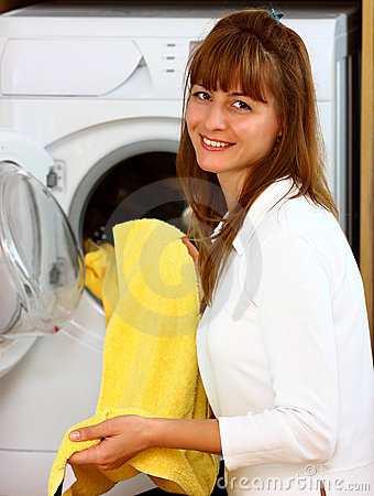 Woman doing laundry with smile