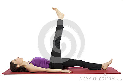 Woman doing leg raising exercises Stock Photo