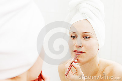 Woman doing make-up after shower