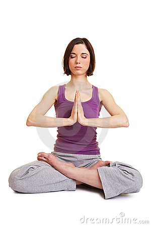 Woman doing meditation in tailor
