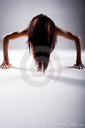 Woman doing press or push ups