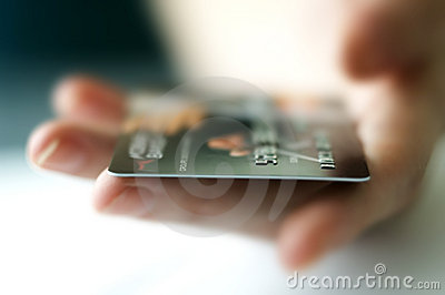 Woman doing shopping and paying by credit card