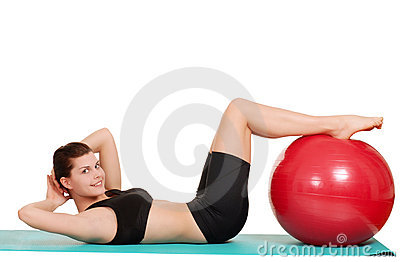 Woman doing sit ups with exercise  ball