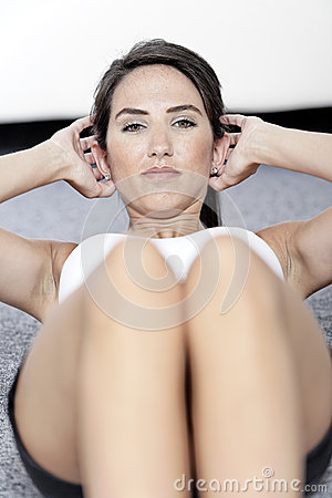 Woman doing sit ups at home