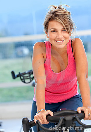 Woman doing spinning in a gym