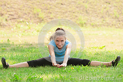 Woman doing sports stretching exercise