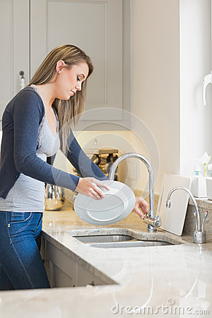 Free Woman Doing The Washing Up Stock Photo - 31009020
