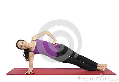 Woman doing a variation of side plank pose Stock Photo