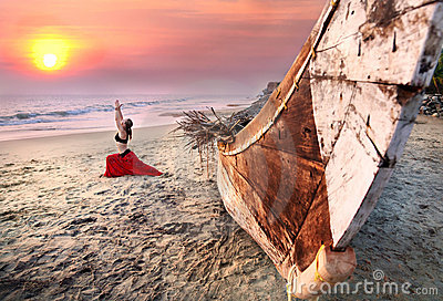 Woman doing virabhadrasana warrior yoga pose