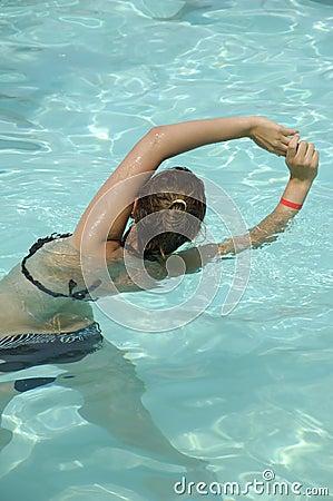 Stock Photo: Woman doing water aerobic