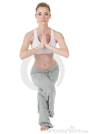 Woman doing yoga, eagle / garudasana position