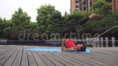 woman doing yoga exercise legs up pose viparita karani