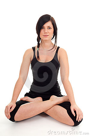 Woman doing yoga exercise in lotus pose