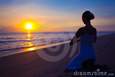 Woman doing yoga exercise outdoors