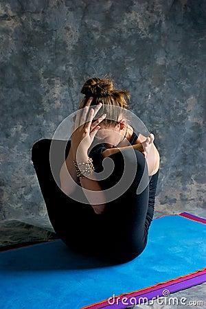 Woman doing yoga exercise Womb pose