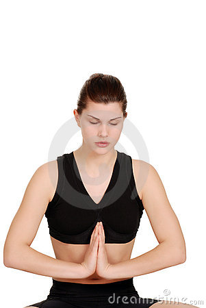 Woman doing yoga with eyes closed