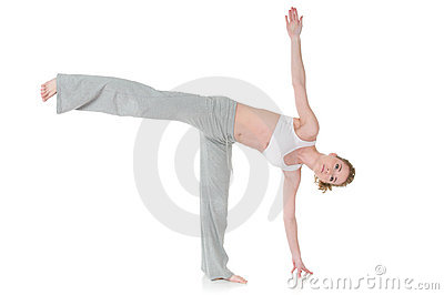 Woman doing yoga, Half Moon/Ardha Chandrasana pose