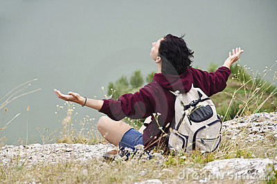 Person relaxing on mountain
