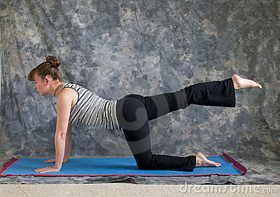 Woman doing Yoga one leg table pose right